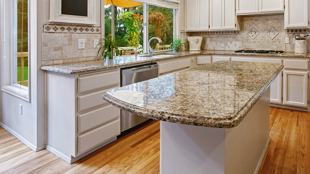 Luxury kitchen with an island supported by Federal Brace's Anthem Corner Support Bracket.